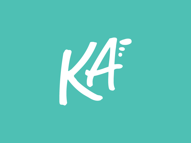 A handwritten K and A monogram with three paint brush strokes on the upper right.